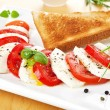 Mozzarella and tomato. Caprese salad. — Stock Photo