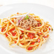 Tasty spaghetti with tomato sauce and tuna. — Stock Photo