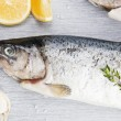 Trout with lemon and salt. — Stock Photo