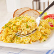 Breakfast. Scrambled eggs. — Stock Photo #27194663
