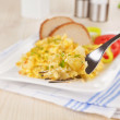 Scrambled eggs on fork. — Stock Photo