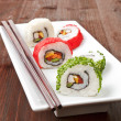 Maki. Luxurious sushi rolls on white plate. — Stock Photo