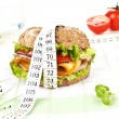 Sandwich with measuring tape. — Stockfoto