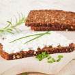 Black bread with cottage cheese. — Stock Photo