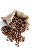 Coffe beans in brown sack. — Stock Photo