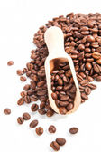 Coffee beans with wooden scoop. — Stock Photo