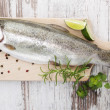 Trout on wooden kitchen board. — Stock Photo