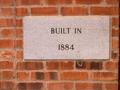 Marble plaque on a brick wall — Stock Photo