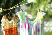 Old dress hang on clothes line — Stock Photo