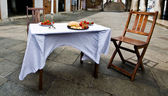 Prepared table with chair — Stock Photo