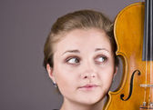 Beautiful girl with a violin in hands — Stock Photo