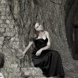 Стоковое фото: Beautiful girl in black evening dress