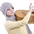 Stock Photo: Young girl in warm hat playing guitar
