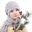 Lovely girl in a gray hat, a yellow jacket and a gray scarf with red bilberry branch in hands on a white background — Stock Photo