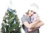 Pretty girl in hat near Christmas tree Snow Maiden with a gray teddy bear in her arms on a white background — Foto de Stock