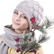 Stock Photo: Young blonde in gray hat and scarf with branch in hands of cowberry on white background