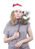 Beautiful girl in a santa hat in a warm sweater on a white background — Stock Photo