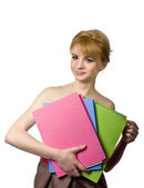 Young and skinny blonde student with colored folders on hand on white background — Stock Photo