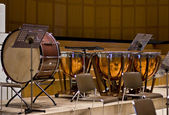 Group of classical percussion instruments on a large wooden stage — Stock Photo