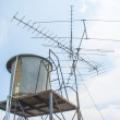 Water tank and tv antenna — Stock Photo #39300193