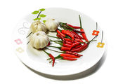 Garlic and pepper in dish isolated — Foto Stock
