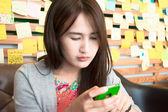 Girl playing smartphone — Stock Photo
