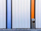 Ashtray bin on steel wall — Stock Photo