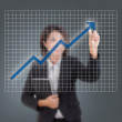 Closeup of young Asian business woman drawing graph — Foto Stock
