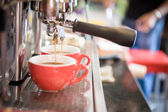 Espresso, extraction from coffee machine — Stock Photo
