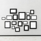 Picture frame on white brick wall — Stock Photo