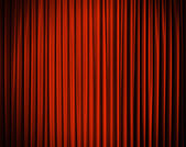 Red closed curtain with light spots in a theater — Stock Photo