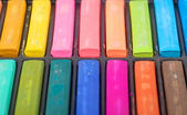 Detail of different colored chalk painting on white background — Stock Photo