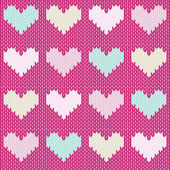 Seamless knitted background with hearts — Stock Vector