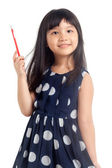 Little girl thinking with pencil — Foto de Stock