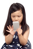 Kid using smartphone — Stock Photo