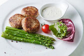 Cutlets with asparagus — Stock Photo