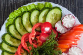 Mixed vegetables. tomatoes, cucumbers, peppers and radishes — Stok fotoğraf