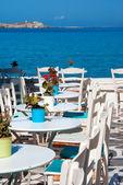 Traditional greek cafeteria on Mykonos island, Greece — Stok fotoğraf