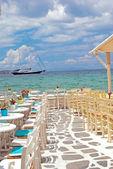 Traditional greek cafeteria on Mykonos island, Greece — Stock Photo