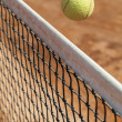 Tennis ball over the net — Stock Photo