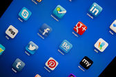 Social media symbols on ipad — Stock Photo