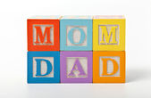 Mon and dad written with play blocks — Stock Photo