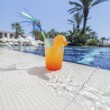 Cocktail at the edge of pool — Stock Photo #31395687