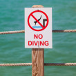 No diving sign on the pier — Stock Photo