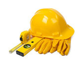 Hard hat, leather gloves and tools — Stock Photo