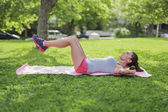 Beautiful young woman doing gym outdoors — Stock Photo