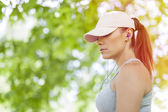 Beautiful young woman listening to music during sports activity — Стоковое фото