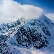 Awesome Aerial View of Mount McKinley, or Denali, with Snow and Clouds Blowing in Heavy Winds at Peak.  Alaska. — Stock Photo