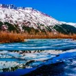 A Colorful Panorama of a Partially Frozen Lake with Mountain Range Reflected in the Great Alaskan Wilderness. — ストック写真 #27786185