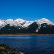 Azure Sky and Snow Capped Mountains Around the Turnagain Arm in the Great Alaskan Wilderness. — Stock Photo #27786267